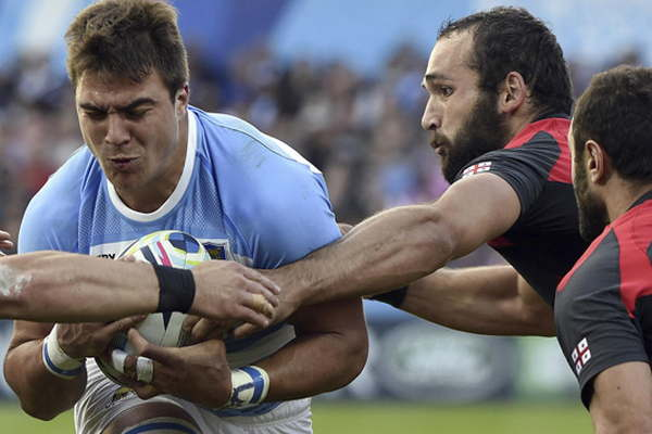 zzzzinte1Argentina's number 8 Facundo Isa (L) is tackled by Georgia's wing Tamaz Mchedlidze (2nd R)   during a Pool C match of the 2015 Rugby World Cup between Argentina and Georgia at Kingsholm stadium in Gloucester, west England, on September 25, 2015.  AFP PHOTO / LOIC VENANCE RESTRICTED TO EDITORIAL USE, NO USE IN LIVE MATCH TRACKING SERVICES, TO BE USED AS NON-SEQUENTIAL STILLS zzzz
